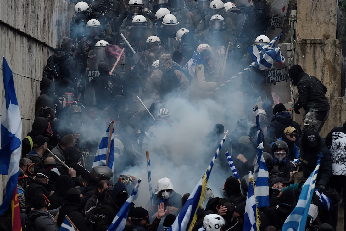 Protesters clash with police near the Greek Parliament during a demonstration against an agreement with Skopje to rename neighbouring country Macedonia as the Republic of North Macedonia, on January 20, 2019, in Athens. - The proposal faces resistance in Greece because of what critics see as the implied claims to Greek land and cultural heritage. For most Greeks, Macedonia is the name of their history-rich northern province made famous by Alexander the Great's conquests. (Photo by Louisa GOULIAMAKI / AFP)