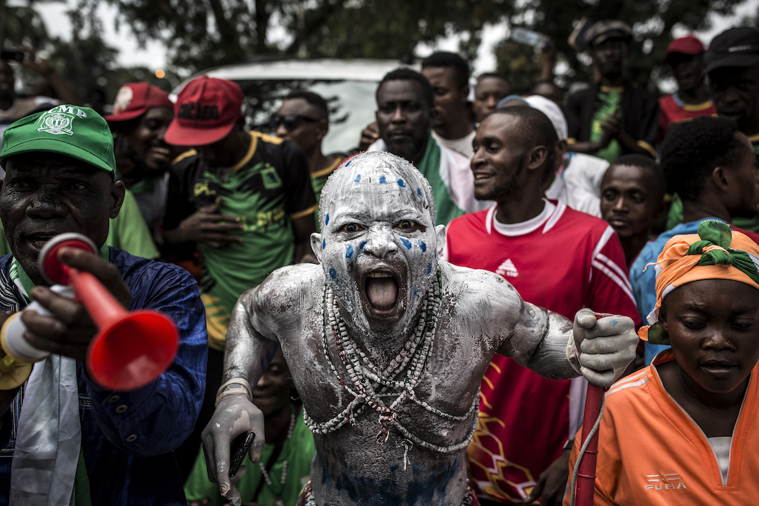 Supporters of newly elected President of the Democratic Republic of Congo Felix Tshisekedi cheer as they arrive to attend his Presidential Inauguration on January 24, 2018 in Kinshasa. - Tshisekedi took the oath of office before receiving the national flag and a copy of the constitution from outgoing president Joseph Kabila, stepping aside after 18 years at the helm of sub-Saharan Africa's biggest country, marking the country's first-ever peaceful handover of power after chaotic and bitterly-disputed elections. (Photo by John WESSELS / AFP)